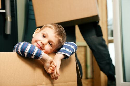 A small boy looking relaxed in a moving box